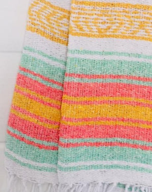 "Measure 74"" x 48"" Colors: Peach, Green, Black & White Fringe detail on two ends Soft blend of cotton, acrylic and polyester Washes well in cold cycle and recommended to air dry Perfect as your favorite couch or bed throw, picnics, concerts, and the beach."