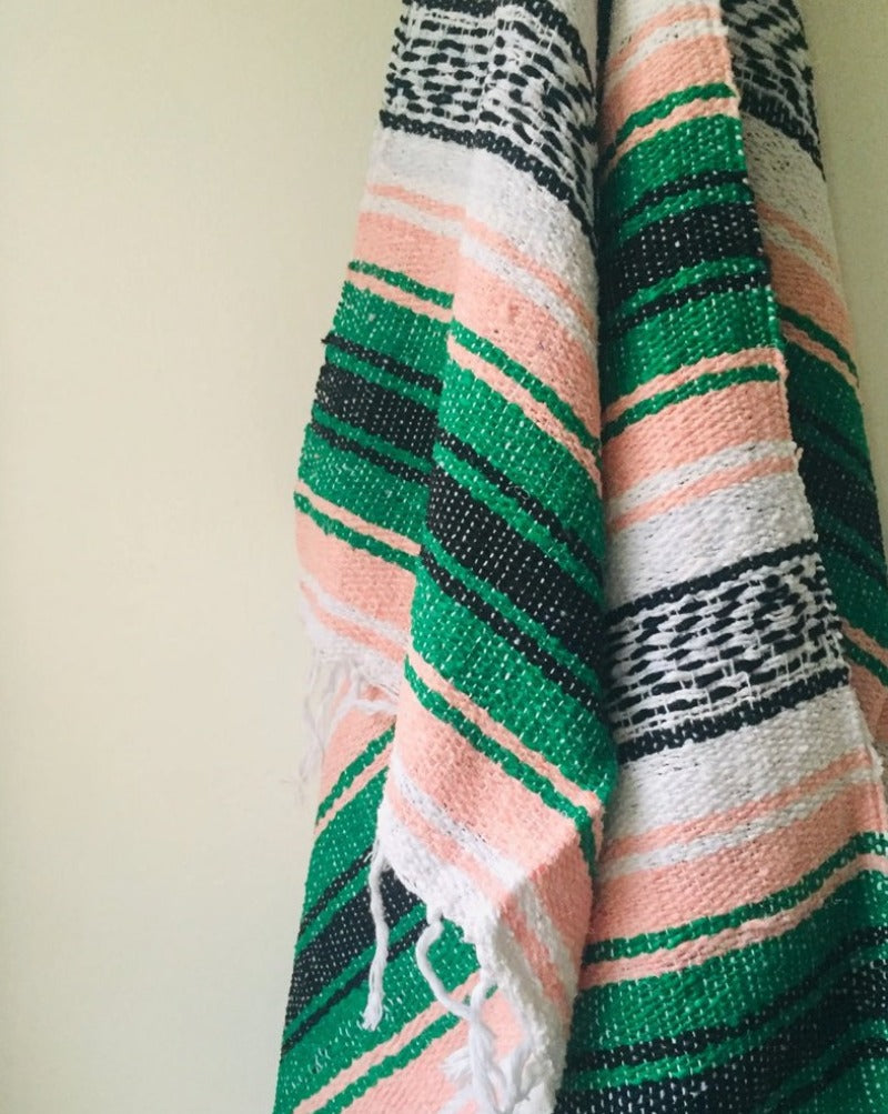 "Measure 74"" x 48"" Colors: Peach, Green, Black & White Fringe detail on two ends Soft blend of cotton, acrylic and polyester Washes well in cold cycle and recommended to air dry Perfect as your favorite couch or bed throw, picnics, concerts, and the beach"