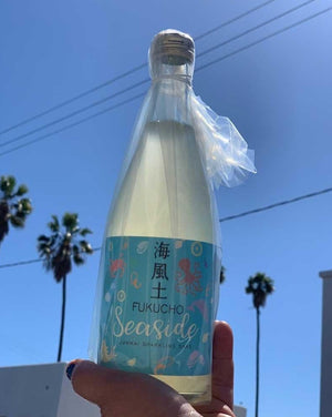 "Fukucho ""Seaside"" 500ml Sparkling Pet-Nat Sake Female Toji (Brewer) - Miho Imada  Junmai - fun, fresh and wild.  Miho makes this sparkling sake through a secondary fermentation in bottle like a pet-nat wine. Super fun aromas of cream, lemon yogurt and finishes tingly and dry!"