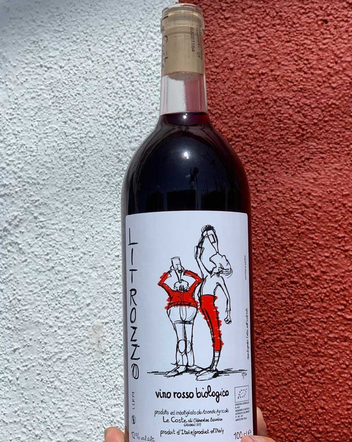 Merlot/Sangiovese Lazio, Italy.  Woman winemaker - Clémentine Bouveron. All natural. Volcanic soil. Chillable red. Cherry toned like a fruit beefcake. Blueberry muffin nose with a salty kissing finish. Total chugger and a liter (bottle + a half!)