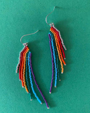 Fringy beaded rainbow earrings accented with either gold or silver-tone beads and hardware. Nickel-free. Handmade in Santa Barbara, California. Approx. 3 inches. Super lightweight.  100% of the proceeds from the sale of these earrings will be donated to The Los Angeles Gay and Lesbian Center @lalgbtcenter.