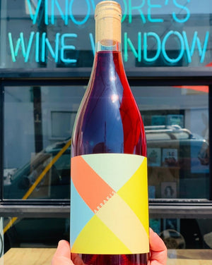 50% Pinot Noir 50% Chardonnay Santa Barbara, California.  Woman winemaker - Kate Vourvoulis. All natural. Chillable red. Adult juice box drinking on a sunny playground. Citrus power punch. Mineral crunch. Super shiny, she's her own red + white lady!