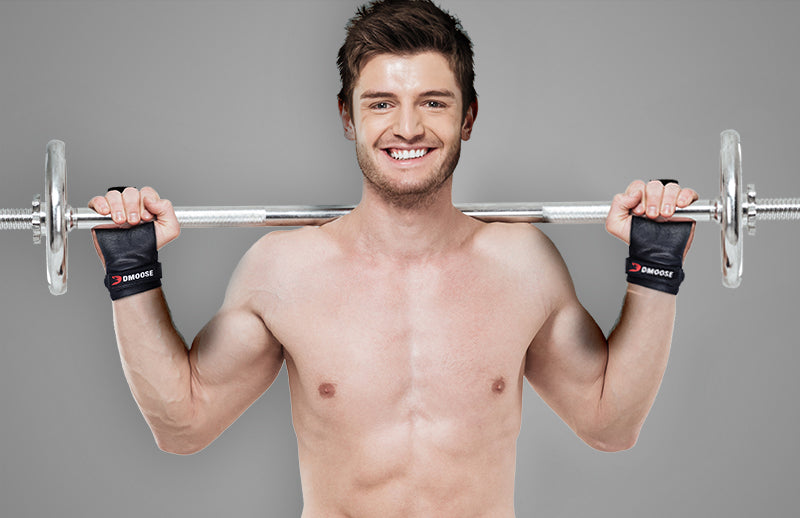 A man holding barbell behind his neck while wearing DMOOOSE weightlifting leather hand grips