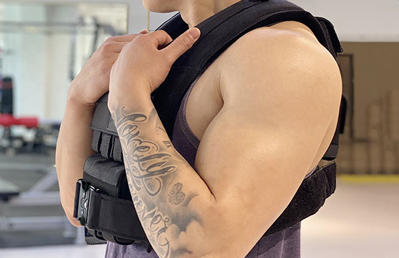 Close view of a man wearing DMoose weighted vest