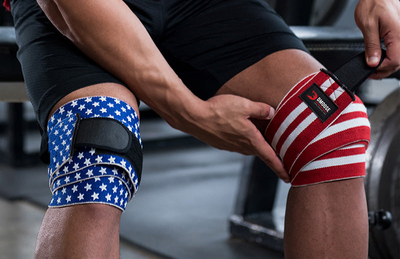 Close view of a man tightning his left knee Dmoose knee wrap