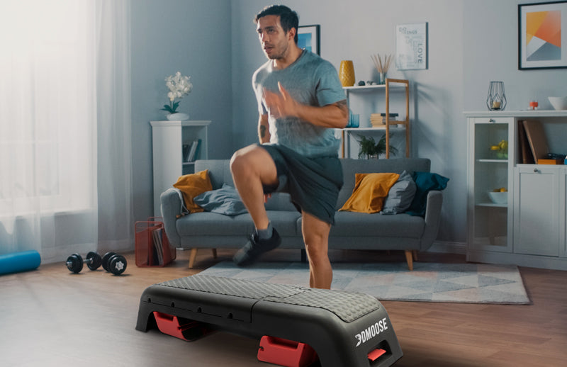 A man doing running workout in home with DMOOSE deck workout bench