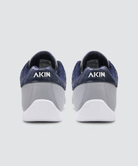 Back view of grey AKIN driving shoe for car enthusiasts.
