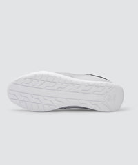 Bottom view of grey AKIN driving shoe for car enthusiasts.