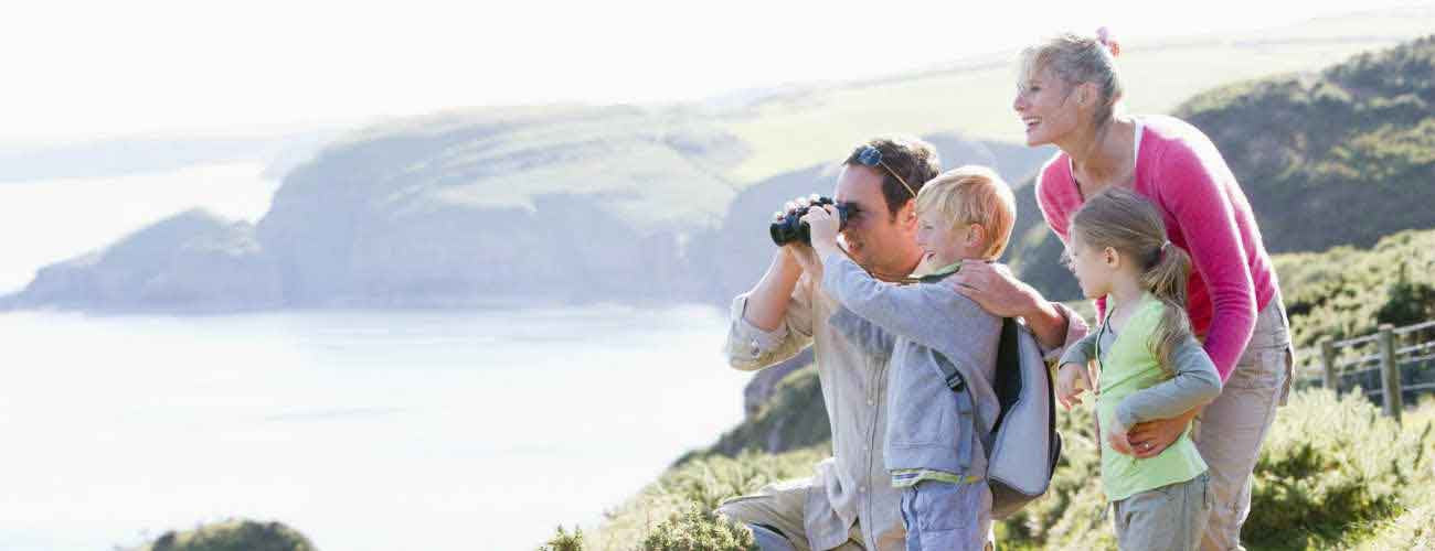 Family using binoculars with children