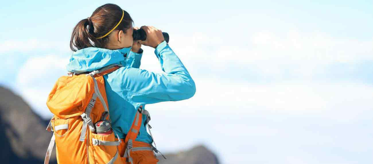 Hiker using binoculars