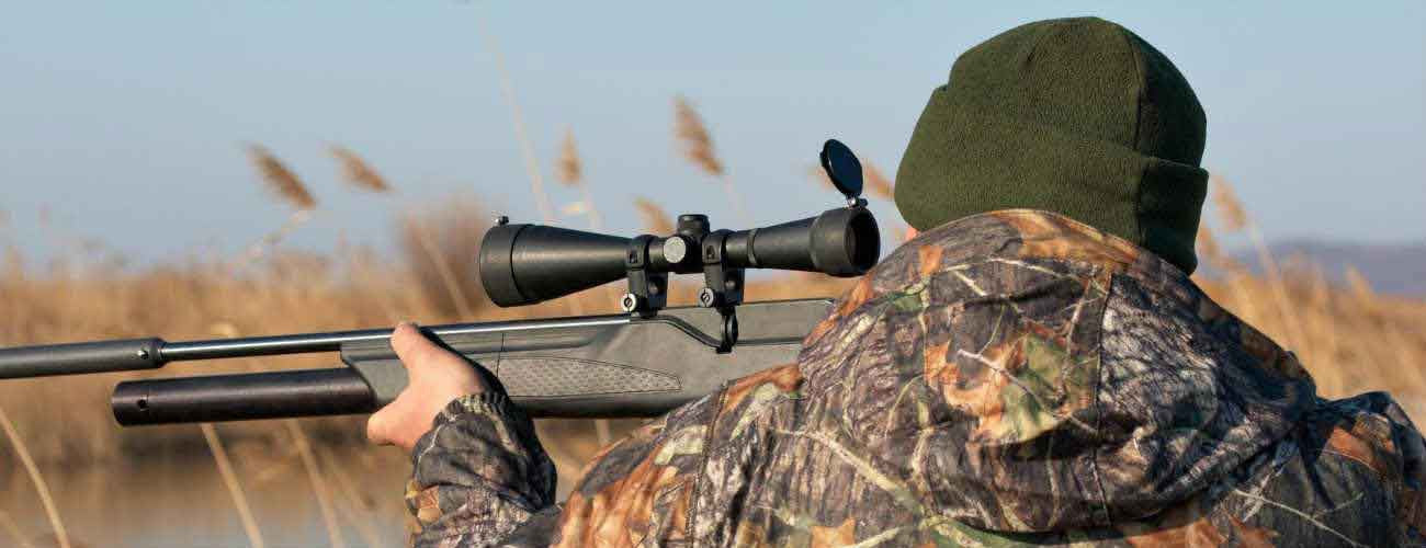 Man using riflescope