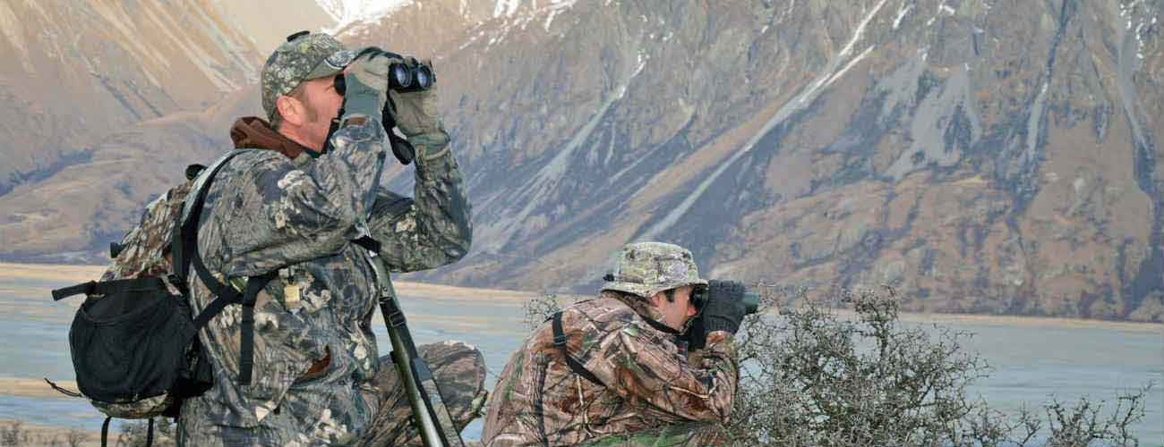 Men using binoculars whilst hunting