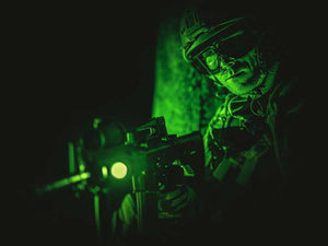 Man using night vision equipment