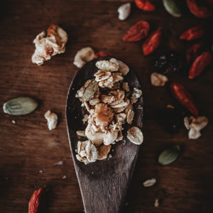 A wooden spoon with Red Lime Jones Granola I am Sassy Granola