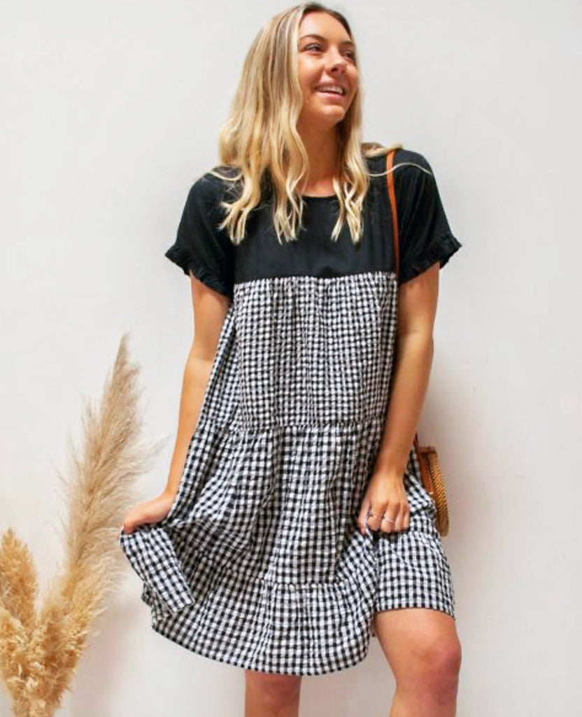 This gorgeous gingham Linen dress is quite generous so we recommend choosing a size smaller than you would normally wear.