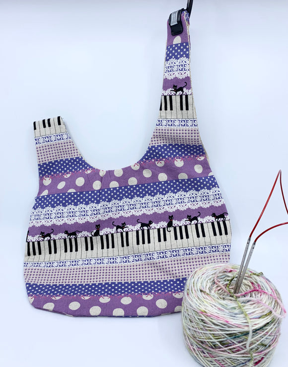 Knot Bag | Sassy Cats on Piano Keys with Lace in Purple
