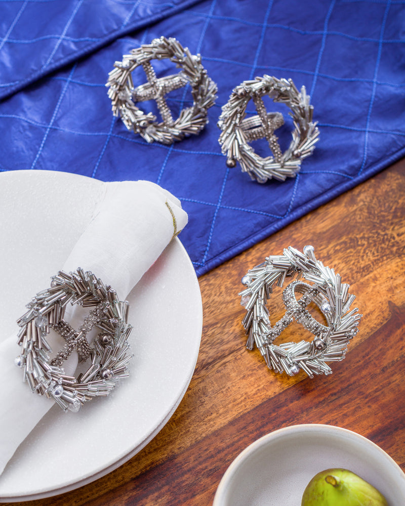 Silver wreath napkin rings