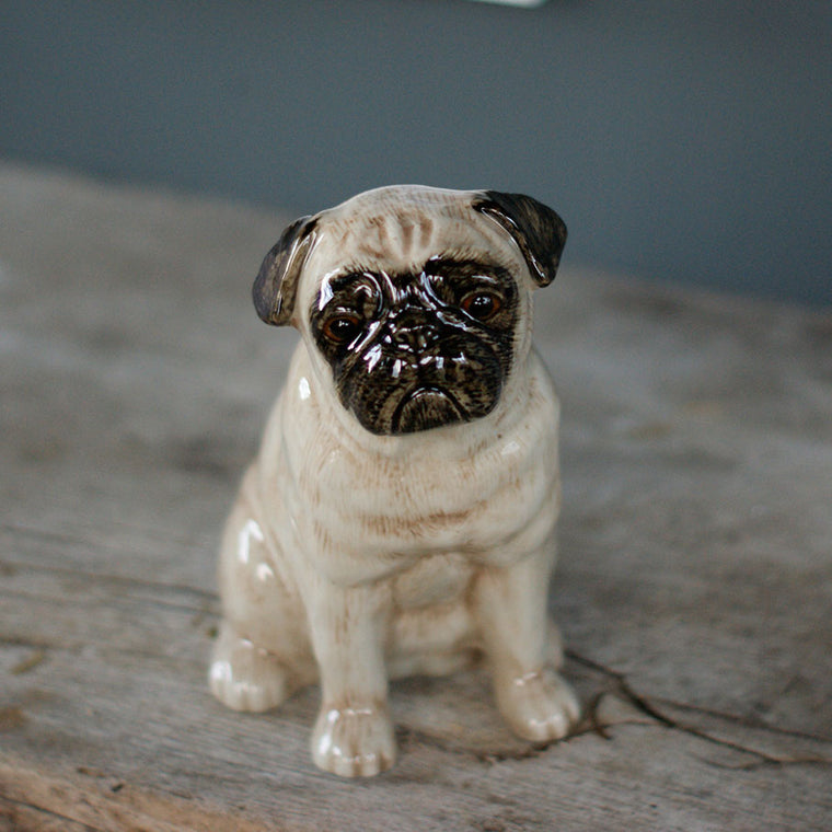 A ceramic Pug dog money box ornament