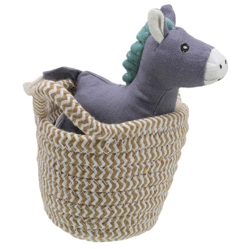 Soft donkey toy in a basket