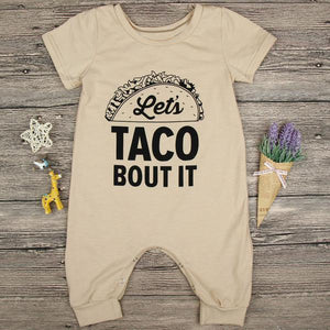 "beige Fun baby romper with ""let's taco bout it"" printed on the front."