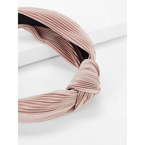 Polyester light pink headband.