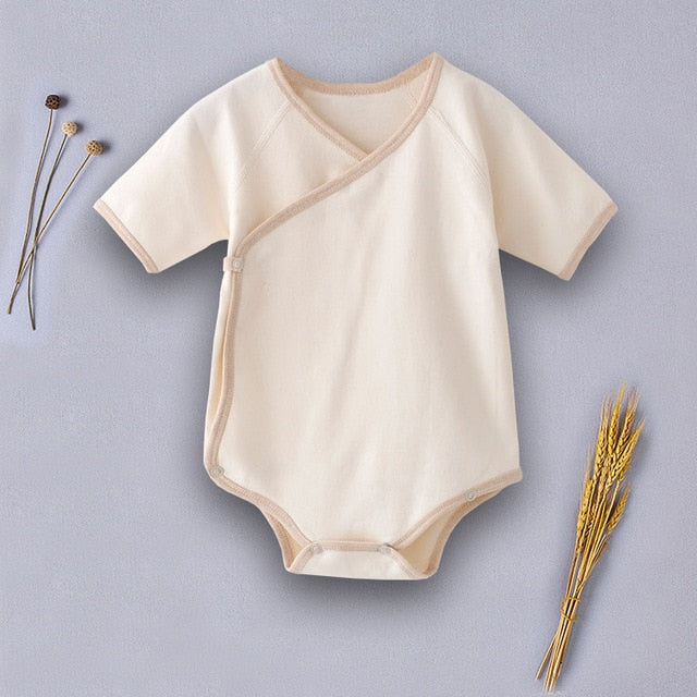 Baby cotton short sleeve kimono-style onesie. Side Buttons