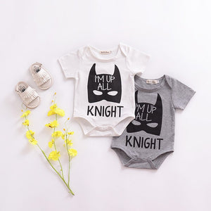 "Baby onesie with batman print and ""I'm up all knight"" message."