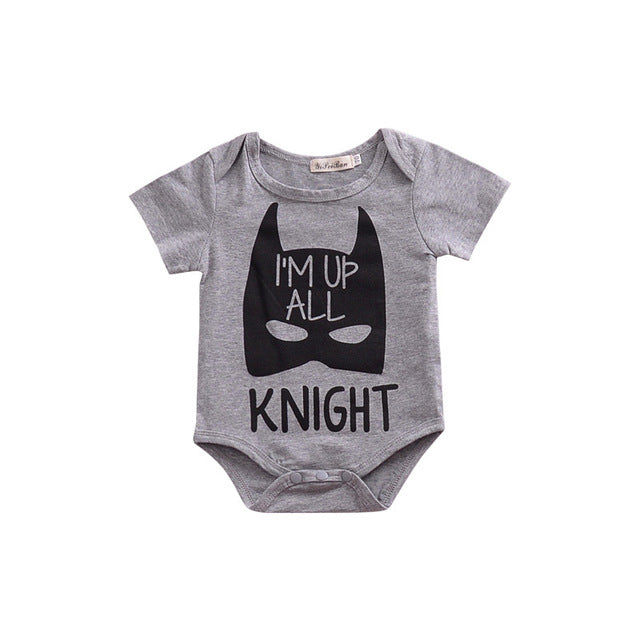 "white Baby onesie with batman print and ""I'm up all knight"" message."