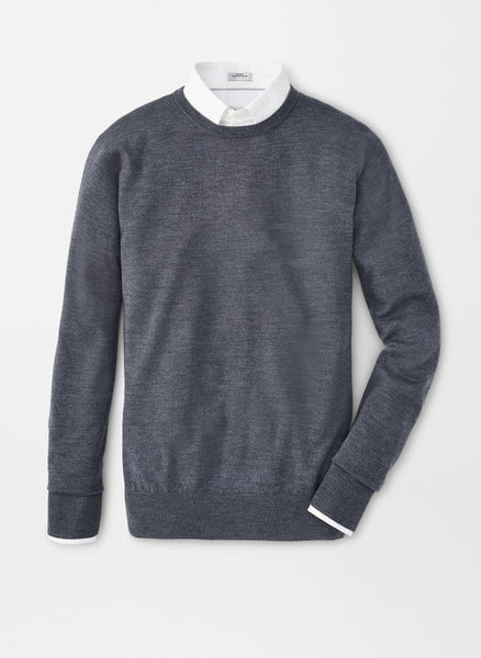 A flat lay down view of the Peter Millar Crown Soft Crew Neck Sweater in Charcoal over a white button down shirt.