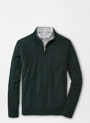 Green merino wool sweater from Peter Millar laid out flat