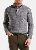 Front view of a man wearing the Peter Millar Wool Cable Quarter Zip Sweater in Gale Grey.