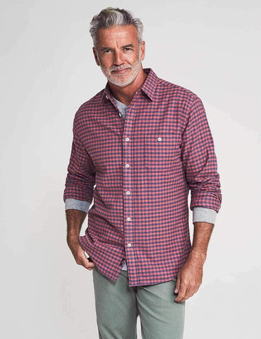 Front view of a man wearing the Faherty Stretch Seaview Flannel in Blue Rose Gingham.
