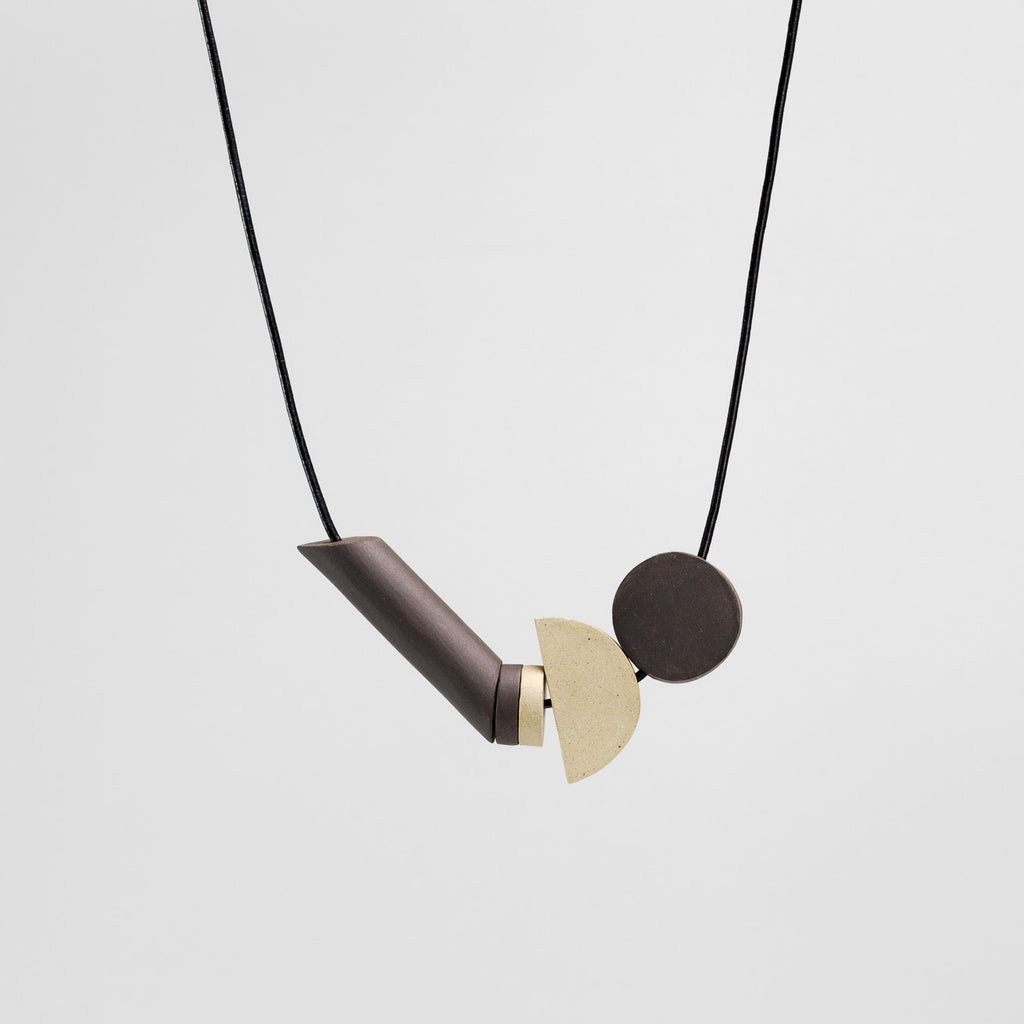 Black Moon Necklace in black and buff stoneware | handmade ceramic jewellery by Labrador