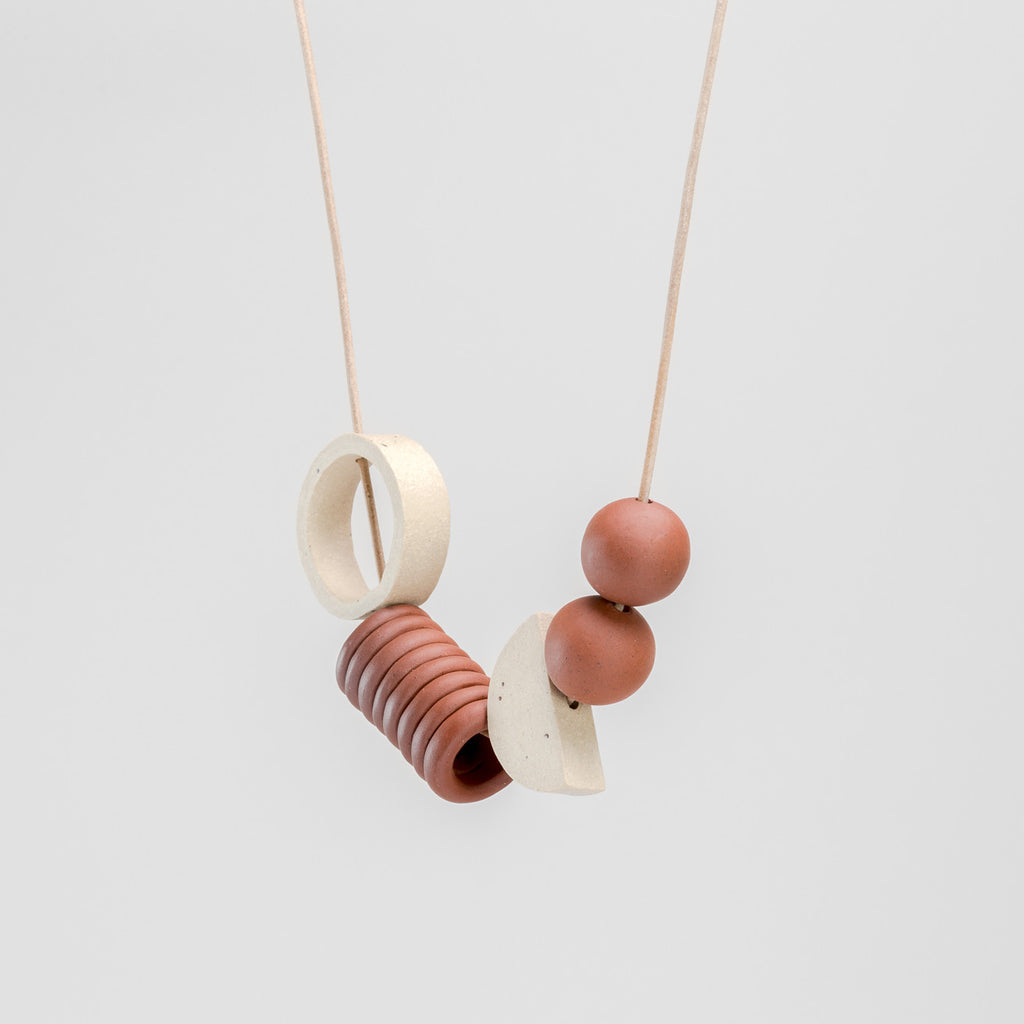 Coil Necklace in white fleck stoneware and terracotta | handmade ceramic jewellery by Labrador