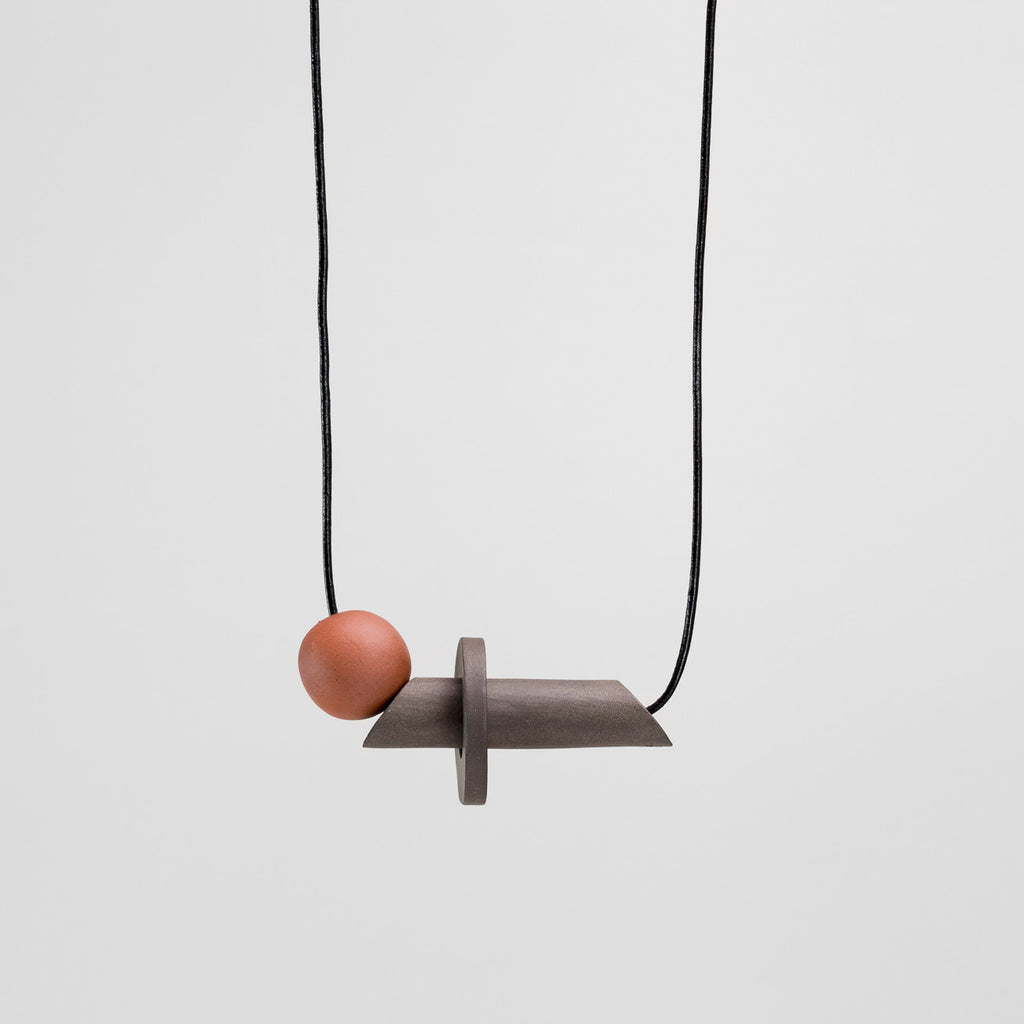 Io Necklace in black stoneware and terracotta | handmade ceramic jewellery by Labrador