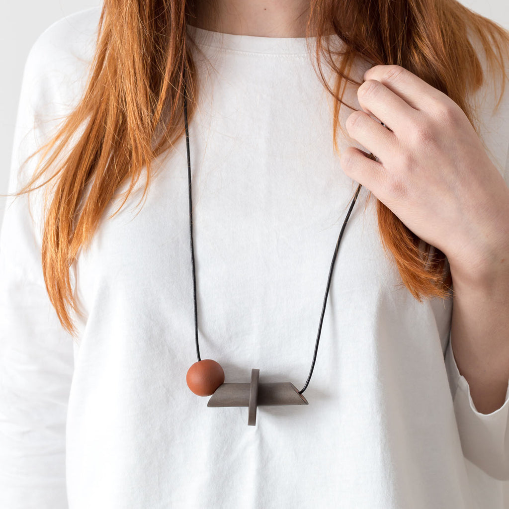 Io Necklace in black stoneware and terracotta (model) | handmade ceramic jewellery by Labrador