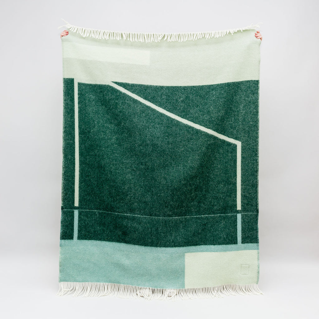 Pure wool blanket Popup in green by Forestry Wool | Textiles for the home at Labrador