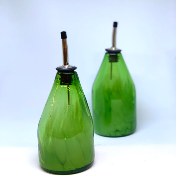 Blown glass oil and vinegar set made from a recycled green bottles at The Olio.