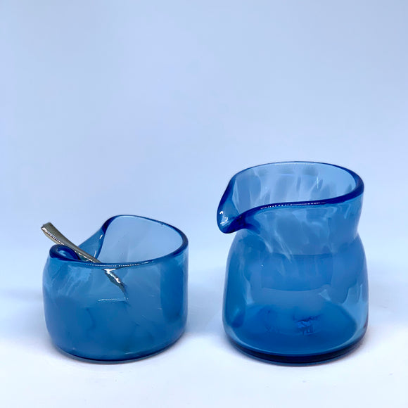 The Olio's blown glass cream and sugar set made from a recycled blue bottles