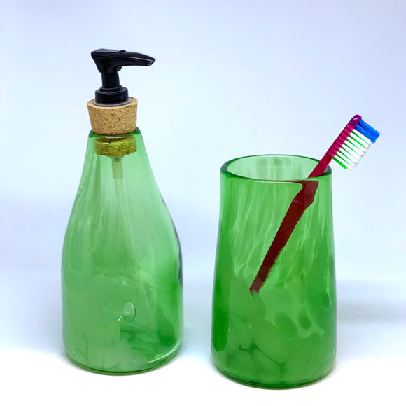 Hand blown glass soap dispenser set made from recycled bottles in bottle green. Set of a soap dispenser and a drinking glass