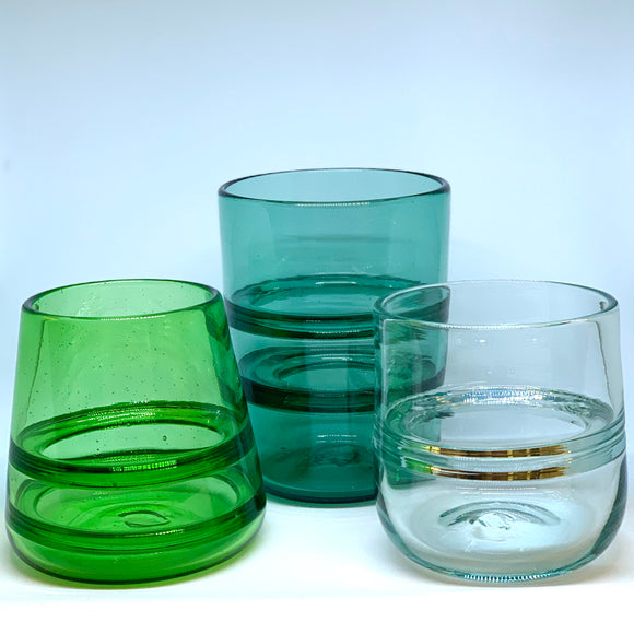 Hand blown glass vase with interior rings by Rebeccah Byer. Sizes medium in transparent green, aqua, and clear.