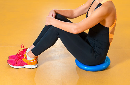 Woman sitting on Balance Disc