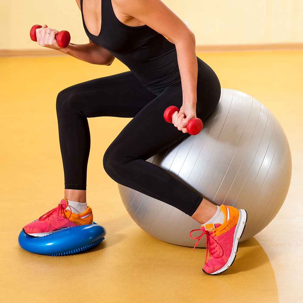 BodySport Balance Disc In Use with Weights and Stability Ball