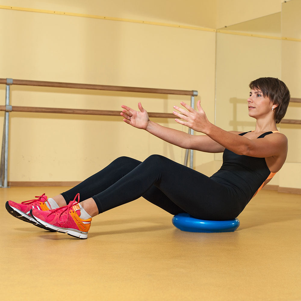 Woman balancing on floor with Balance Disc Pro
