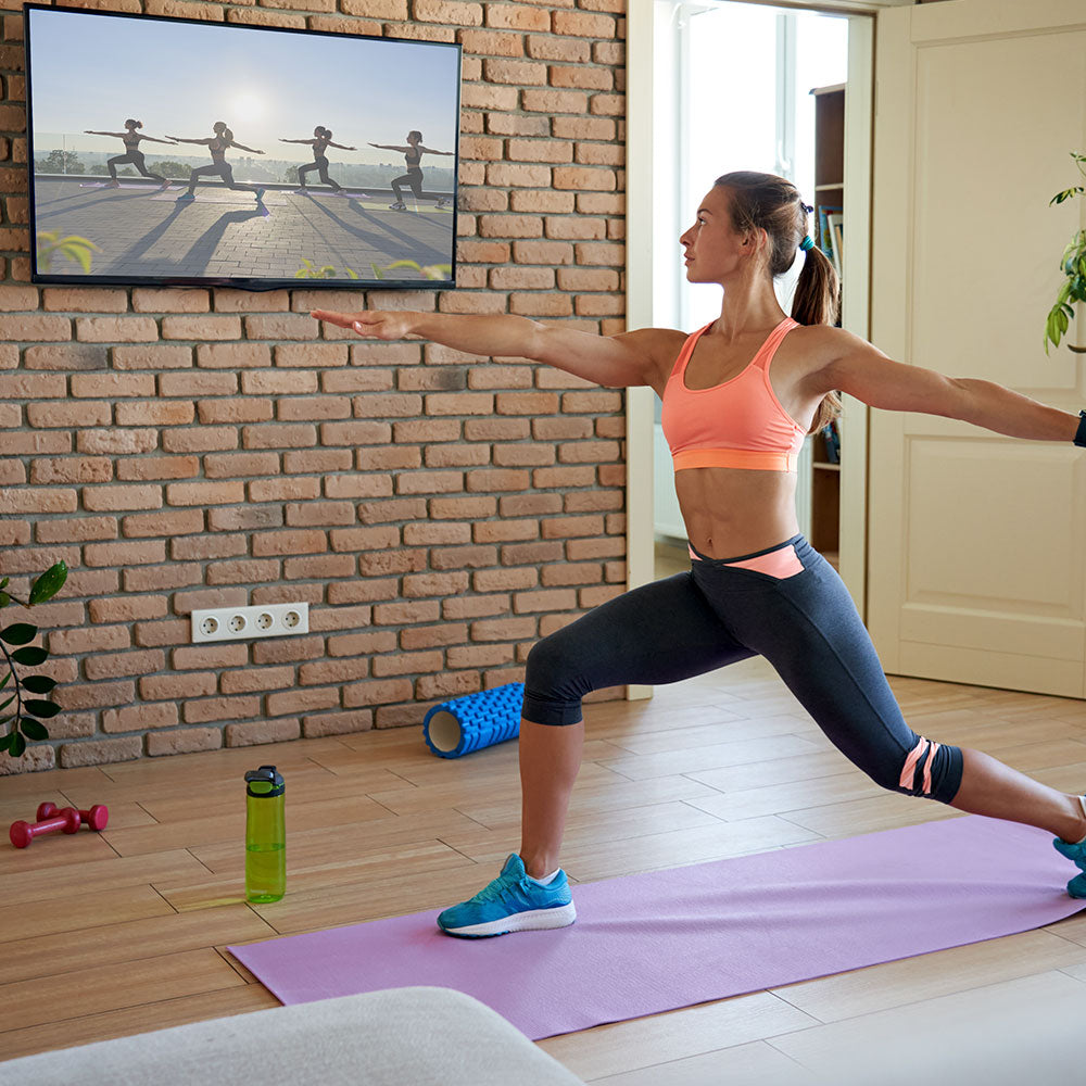 Woman working out with virtual class