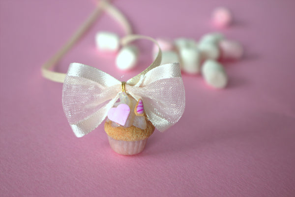 Unicorn cupcake with bow necklace