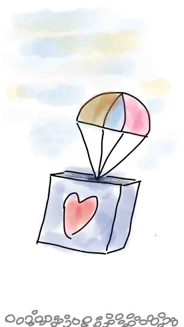 Box with a heart and with a parachute falling out of the sky
