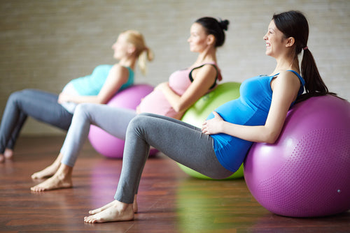 pregnant women exercising with balls