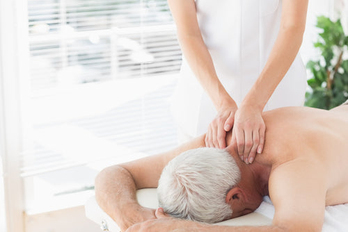 elderly man getting back massage