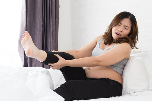 pregnant woman with leg cramp
